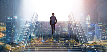 Businessman Climbing The Stairs Of Success Used as a Representation of Profitable Results